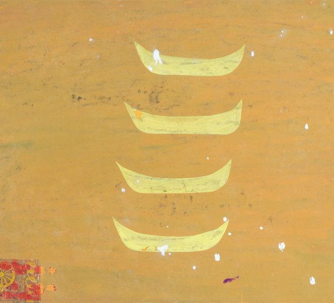 Quattro barche gialle e carte di caramella